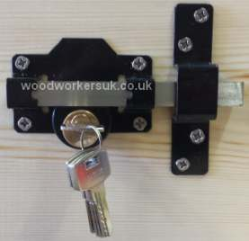 A double locking long throw gate lock