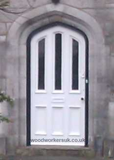 Tudor arched wooden door