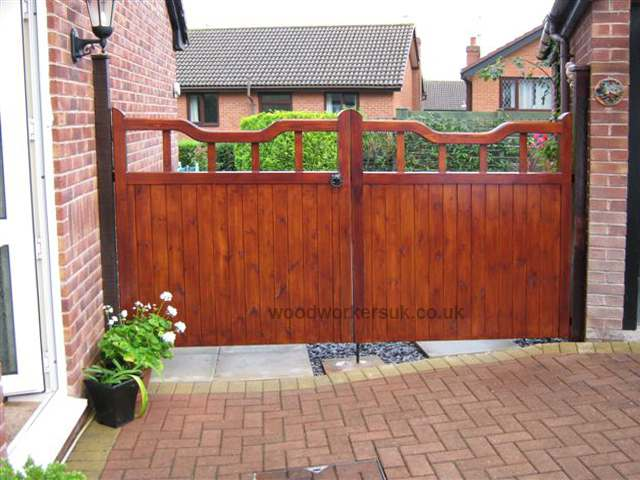 Our Bala driveway gates in Unsorted Scandinavian Redwood (Softwood) with their distinctive 'dropped' head