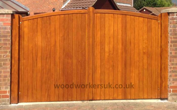 Close boarded Curved headed driveway gates in Idigbo (Hardwood)