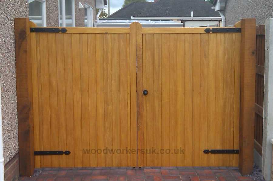 Denbigh driveway gates shown in Idigbo (Hardwood).