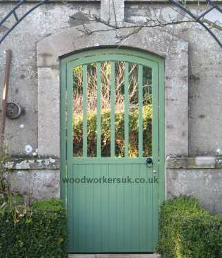 Entrance to a walled garden with gate in place!