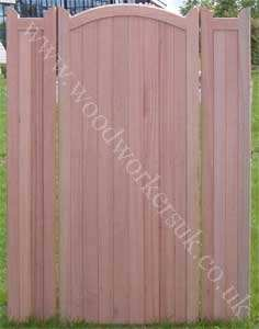 One of our Curved headed gates in Hardwood, with two flanking fence panels.