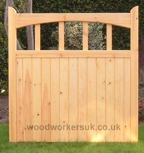 Harlech pedestrian gates shown in Unsorted Scandinavian Redwood (Softwood), with their underswept head.