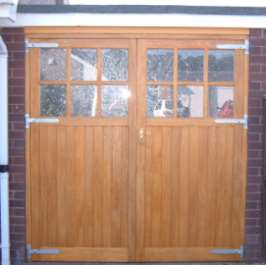 Same size garage but with full height garage doors once the panelled section has been removed!