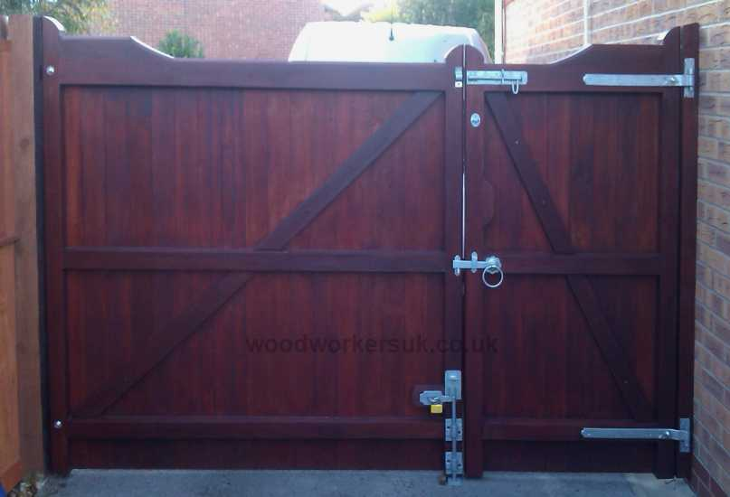 Rear view of our Nannerch driveway gates in Meranti (Stained with a Mahogany stain)