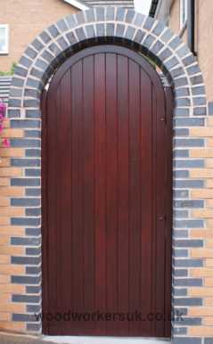 Our semi-circular arched gate as a postern gate, hung from gate posts. Arch built after the gate