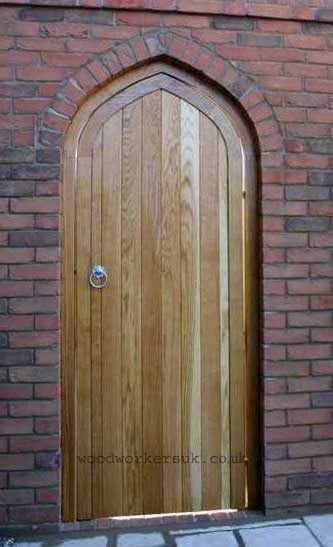 Tudor arched gate in Prime European Oak with matching frame to suit a brick archway