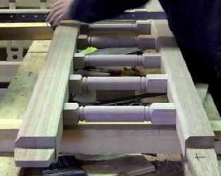 The turned spindles being positioned within the gates.
