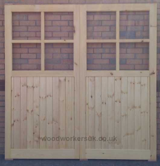 Brenig garage doors with four openings for glazing per door. Pictured in Unsorted Scandinavian Redwood (Softwood)