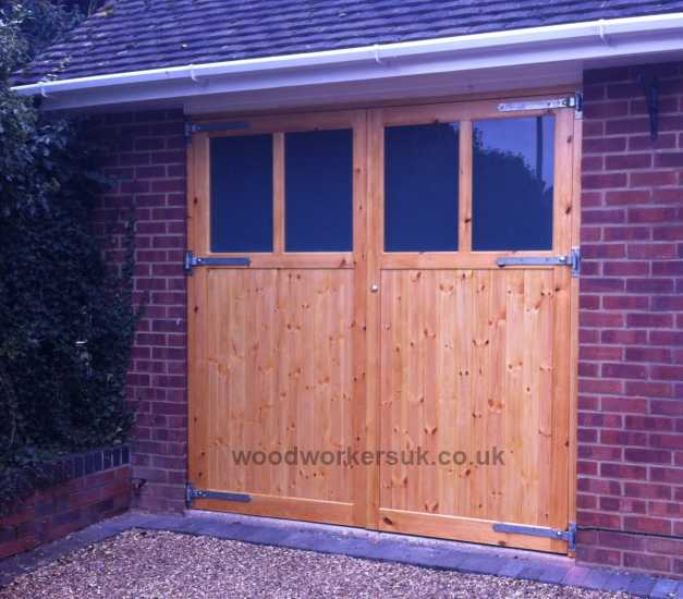 Elwy garage doors pictured in Unsorted Scandinavian Redwood (Softwood). As with all our doors these are made to measure and can be further customised to your requirements