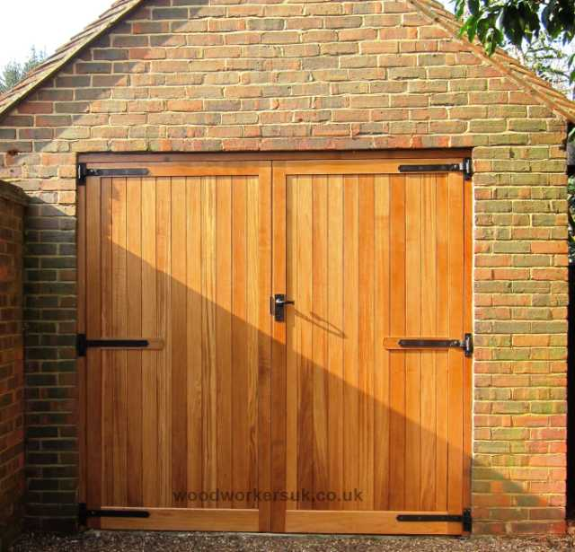 Our Alyn garage door is a true framed, ledged and braced garage door with a solid, full thickness bottom rail. Shown in stained Idigbo