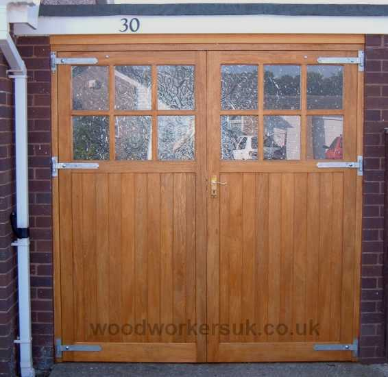 Our Conway garage doors comprising six openings for glazing per door. Shown in Idigbo (Hardwood)