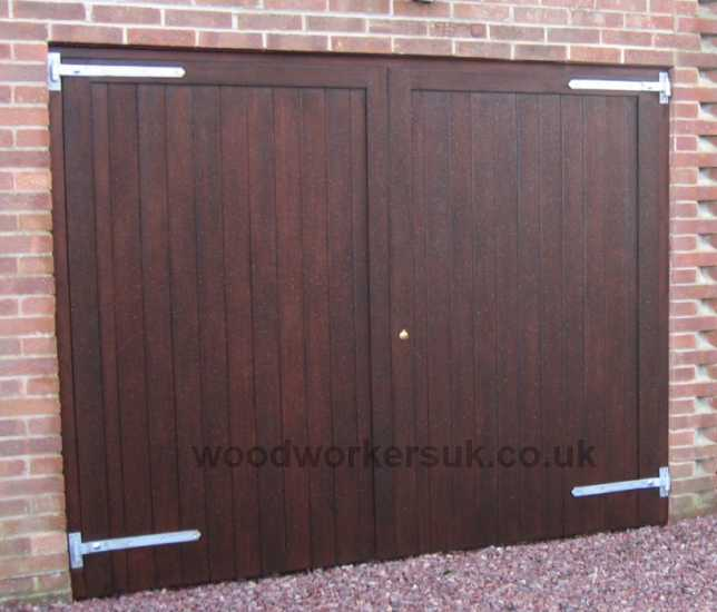 Our Clwyd garage doors shown in stained Unsorted Scandinavian Redwood (Softwood). Made to measure in a choice of five smooth planed, hand sanded timbers!