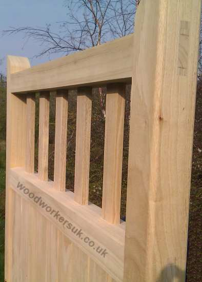 Close up of the St Asaph head/top rail, in Idigbo. The vertical infills are morticed & tenoned into the frame of the gates