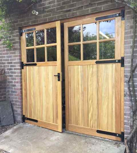 garage doors hung with cranked band and gudgeon hinges